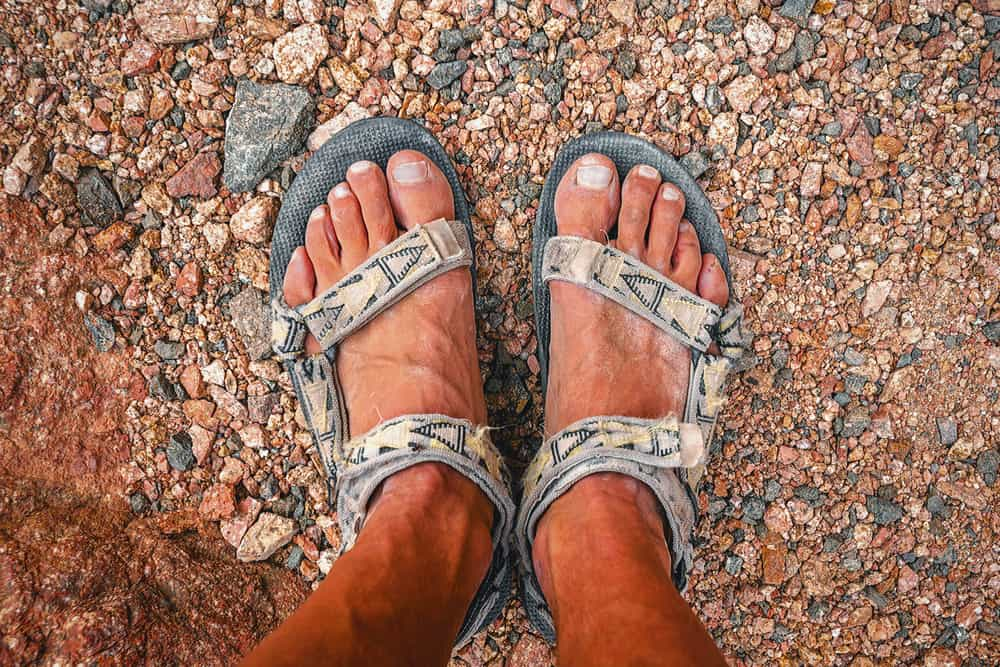 man in sandals after a long hike