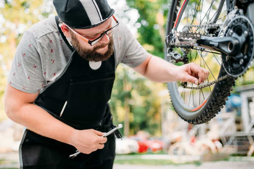Male mechanic repairing bicycle
