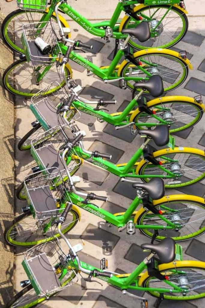 SEATTLE, WASHINGTON STATE, USA - JUNE 2018 Row of bicycles for hire parked in their doking stations as part of the LimeBike rental program
