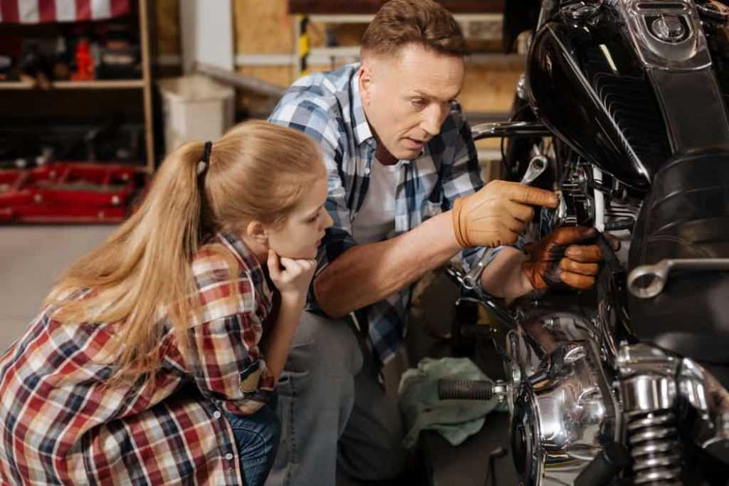 Vibrant charismatic mechanic being a tutor for his child