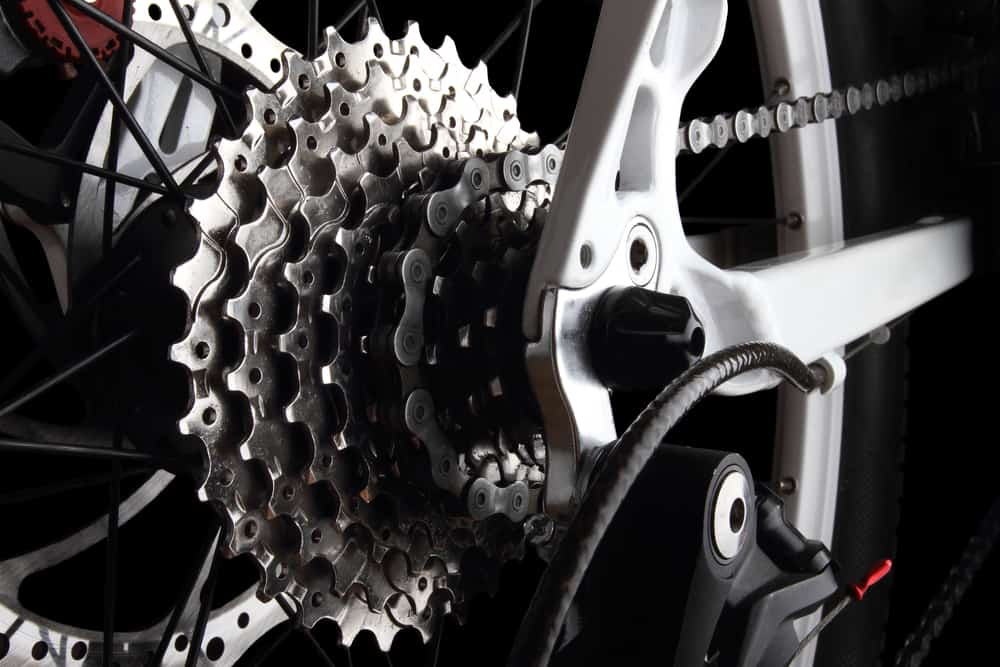 how to put bike chain back on derailleur